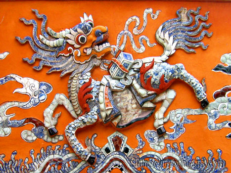 A qilin made mostly out of broken glass and porcelain