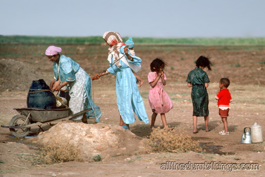 Moroccan women getting water from a well out in the middle of nowhere