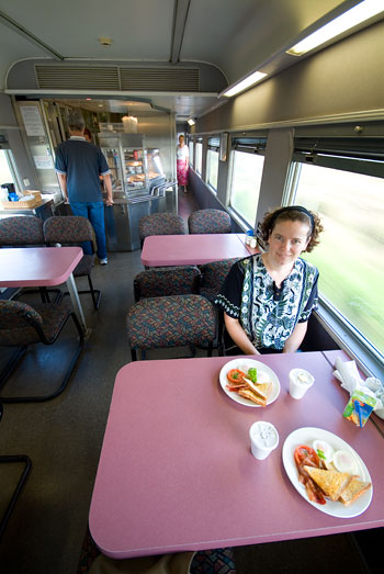 Engogirl having breakfast in the dining car